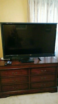black flat screen TV with brown wooden TV stand Byron, 31008