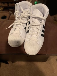 Pair of white-and-black adidas superstar Randallstown, 21133