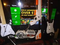 Xbox 360 s comes with two wireless controllers,two guitars, cabellas shotgun,and games null