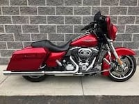 Red and black touring motorcycle Titusville
