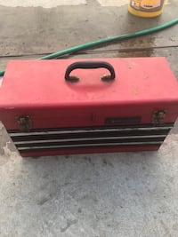 red and black metal tool chest