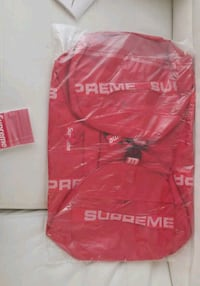 red and white Supreme crew-neck shirt Surrey, V3R 4J6