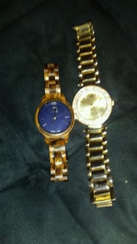 two round gold analog watches with link bracelets 1460 mi