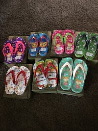 toddler's several assorted print flip flops with box