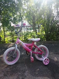 toddler's pink and white bicycle with training wheels 521 km
