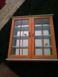 Wooden, glass doors, and paintable shelf  Colorado Springs, 80910