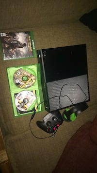 black Xbox One with controller and game cases Montréal, H1G 6K2