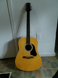 brown and black acoustic guitar Summerville, 29485