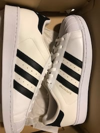 pair of white adidas Superstar shoes with box, brand new never worn size 9.5 Lubbock, 79416