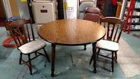 round brown wooden table with two chairs Omaha, 68114