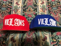 two blue and orange Villains-embroidered fitted caps