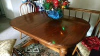 oval brown wooden dining table 45 km