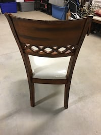 Brown wooden framed white padded chair Lewiston, 14092