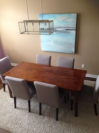 brown wooden dining table with chairs