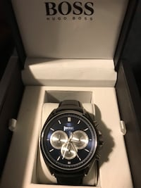 round black chronograph watch with black leather strap Vaughan, L4H 3E6