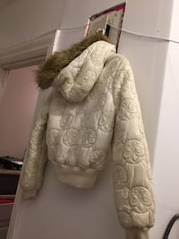 fleur-de-lis quilted white fur-trimmed hooded jacket