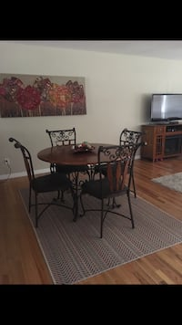 round brown wooden table with four chairs dining set Tampa, 33629