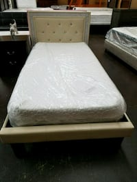 Off white platform bed with a combo mattress