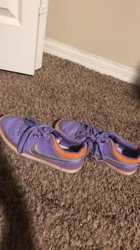 Pair of purple nike low-top sneakers size 9 Palm Bay, 32908