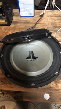 Black and gray jl audio subwoofer 10 inch  Lancaster, 93536