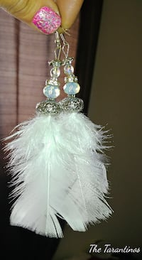 pair of silver-colored and white feather hook earrings Winnipeg