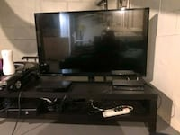 flat screen TV and brown wooden TV stand Baltimore, 21214
