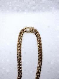 Gold chain link necklace with pendant