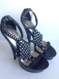 women's pair of black ankle strap pumps heela