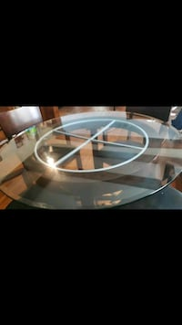 High top glass and dark wood dining room table