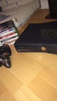 Black Xbox 360 console comes with 2 controllers and 8 games Vaughan, L4J