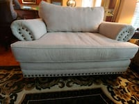 Cream loveseat and ottoman. In good used condition Roanoke, 24018
