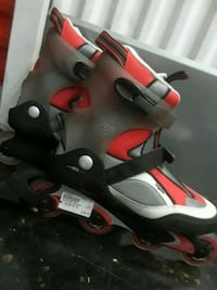 pair of black-and-red inline skates Winnipeg, R2V 2J6