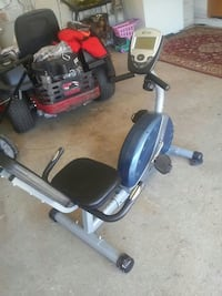 blue, black, and gray stationary bike