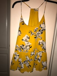 Yellow mustard colored blouse.