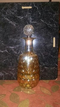 clear brown glass bottle with lid