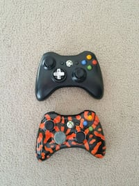 two Xbox 360 game controllers London