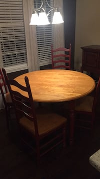 round brown wooden table with four chairs dining set Naperville, 60540