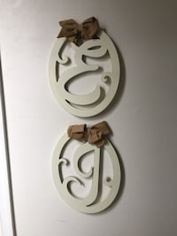two white wooden wall decors