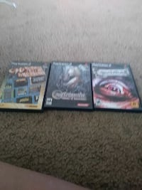 three Sony ps2 game cases