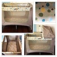 white and gray floral Graco pack n play 528 km