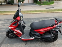 Red and black motor scooter Edina, 55435