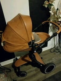 baby's brown and black stroller Toronto, M6H 1Y4