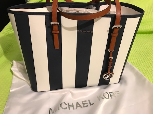 c6cdff34e904af Used white and black striped michael kors leather tote bag for sale in  Greeley