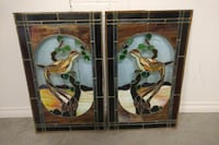 two stained panel painting of brown birds
