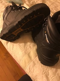 Men's size 7.5 Dunlop steel toe boots. New East Bernstadt, 40729