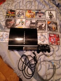 black Sony PS3 original console with game cases Laurel, 20708