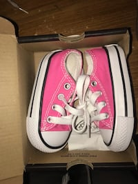 Pair of white-and-pink sneakers Houston, 77091