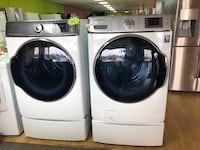 Samsung white washer and dryer set with pedestals