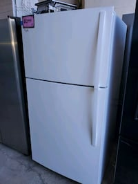 Whirlpool top and bottom fridge working perfectly  Baltimore, 21223