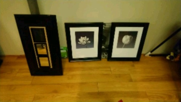 two black wooden framed wall decors x3